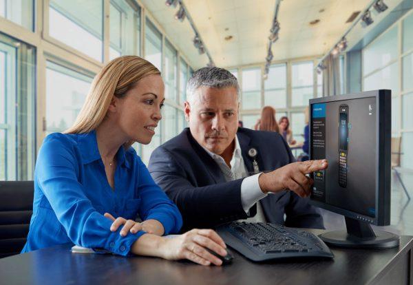 man-and-woman-looking-at-computer